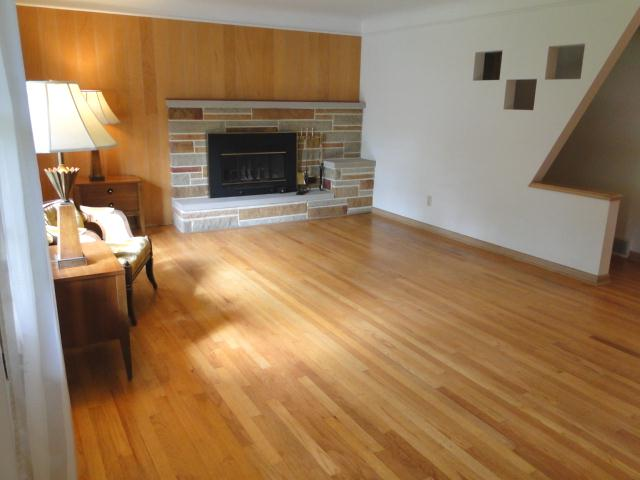 Living room with fireplace & hardwood flooring