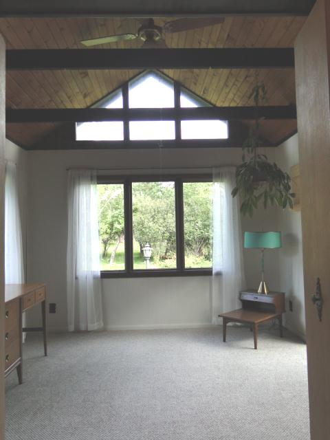 Sunroom with many windows and new carpet